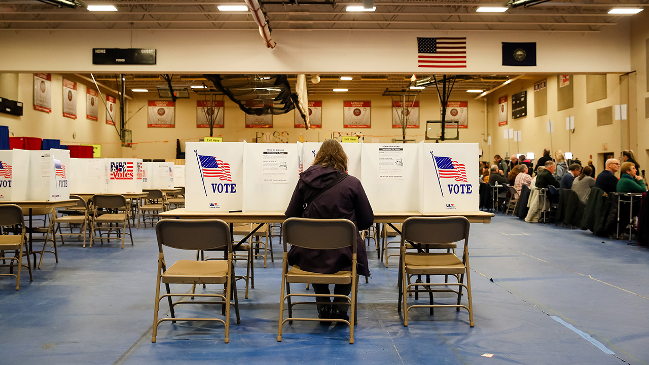 A voter casts a ballot in Bedford, New Hampshire, for the state's primary on Feb. 11. (Matthew Cavanaugh/Getty Images)