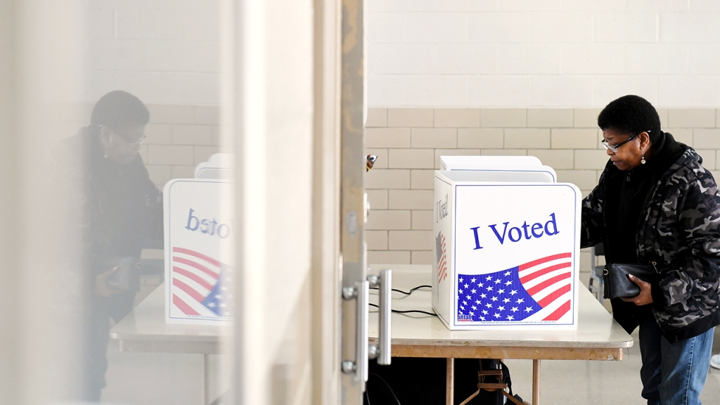 A woman votes in the Democratic primaries at a Columbia, South Carolina, polling place on Feb. 29. (Matt McClain/The Washington Post via Getty Images)