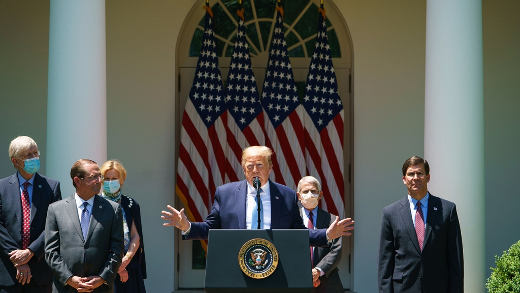 President Trump speaks on vaccine development in the White House Rose Garden on May 15, accompanied by NIH Director Francis Collins, HHS Secretary Alex Azar, coronavirus task force coordinator Deborah Birx, National Institute of Allergy and Infectious Diseases Director Anthony Fauci and Defense Secretary Mark Esper. (Mandel Ngan/AFP via Getty Images)