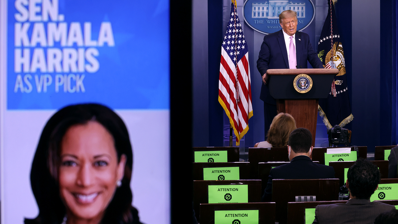 President Donald Trump speaks as a picture of Democratic vice presidential nominee Kamala Harris is seen on a screen during a news conference in the White House. (Alex Wong/Getty Images)